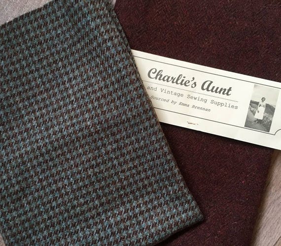 Two pieces of toning British wool tweed fabric - one hounds' tooth check and one plain herringbone weave in green and tan shades