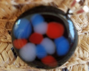 Black, blue and red fused glass pendant.