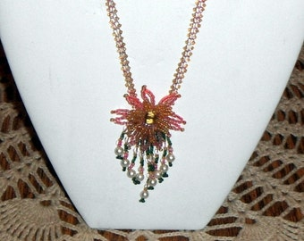 Hand-made Fuschia Starburst netted necklace, flower