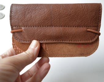Wallet of brown leather with an orange print