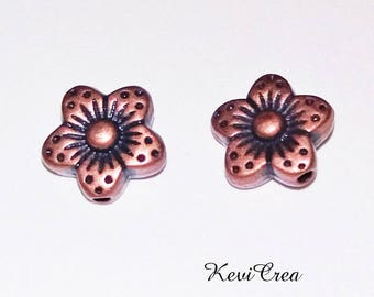 14 x flower copper metal beads