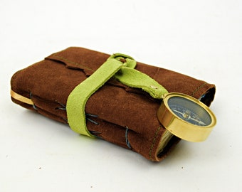 Small leather travel journal with compass and cotton rag paper