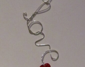 Free Form Sterling Silver Wire Writing; added Swarovski Crystal Heart. Great for Gifts