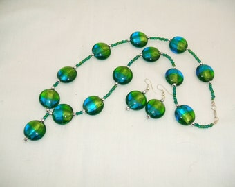 Blue/green beaded necklace and matching earrings.