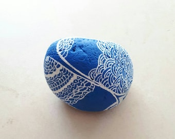 White on blue painted stone