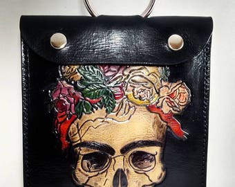 Leather bag on carved