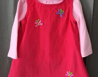 Girl's size 12 mo. corduroy jumper with lt. pink turtleneck.