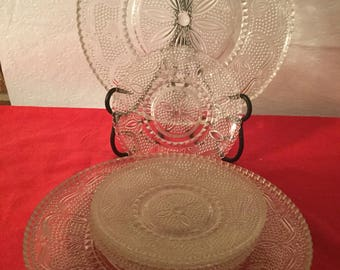 Federal Heritage  clear glass plates and saucers .