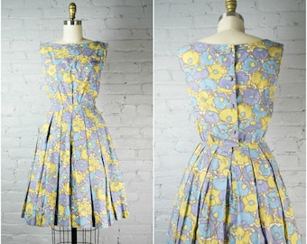 Vintage 50s style dress . 1950s 1960s floral print pleated purple cotton day dress mad men . small
