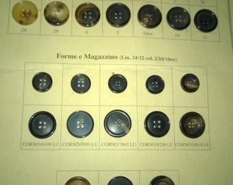 Board of twenty-six resin buttons