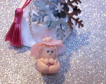 Snowflake bookmark and Pixie baby