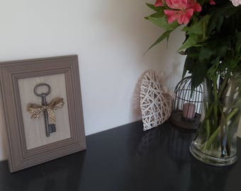 Frame with key