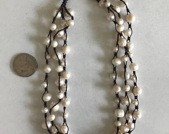 FRESH WATER PEARL - triple strand necklace on genuine leather cord. Pearl clasp