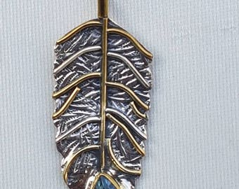 Sterling silver 92.5% feather pendant with sky blue topaz studded