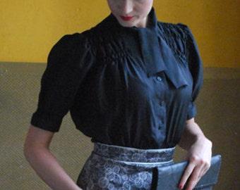black, smocked blouse in silk