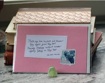Hush, my dear, lie still and slumber Holy angels guard thy bed... Isaac Watts Pale pink card with handwritten quote and Swedish postal stamp