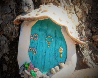 Fairy Garden Door  Mushroom turquoise is 6 inch tall X 5 inches wide X 2 inches thick.Shaped like a big mushroom complete with  planter