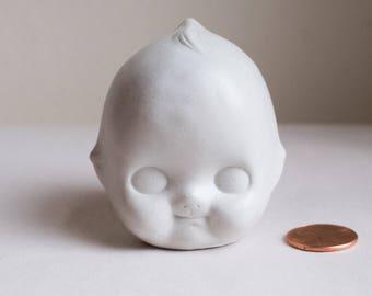 Tête de poupée mini