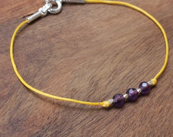 Waxed cotton bracelet with small gemstones and sterling silver beads.