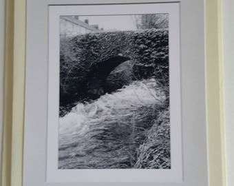 A black and white photograph of the Ivy bridge, Devon.