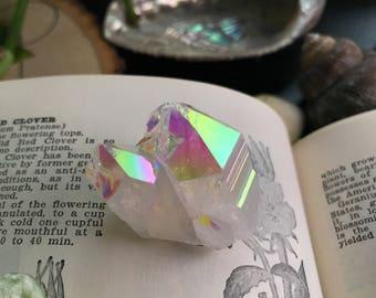 Glowing rainbow angel aura Quartz cluster