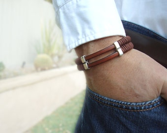 Free Shipping. Men's Leather and Weaved Cord Bracelet: Genuine Tan Leather, Silver Sliders with Magnetic Clasp.