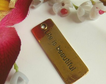 pretty rectangular pendant with inscription
