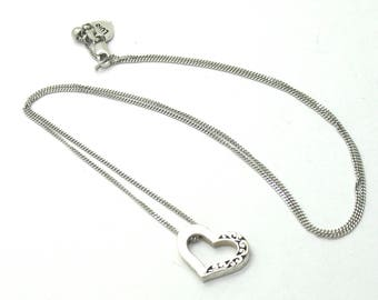 Lois Hill .925 silver chain necklace with small cutout and hammered heart pendant.