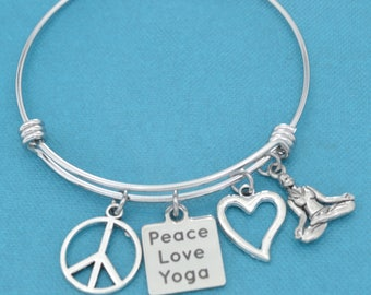 Peace Love Yoga bangle bracelet in stainless steel with silver plated peace sign, silver toned metal heart and silver pewter woman.
