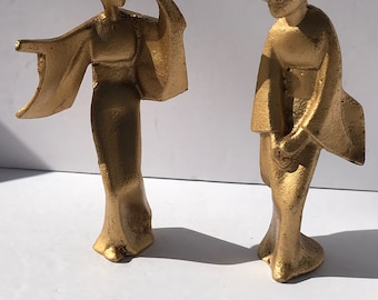 Vintage gold color metal art deco statues very heavy. omc  Otagiri mercantile company Japan
