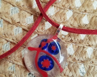 Red and blue fused glass flower pendant.