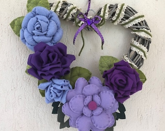Garland at heart with lilac and purple felt flowers