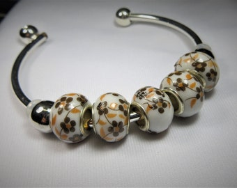 Ad-a-bead Bangle,  Brown and Orange Flower Design