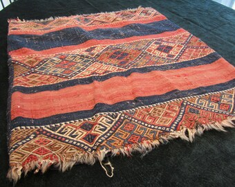 Reduced. antique floor cushion, handwoven rug fabric, reds and blues