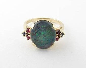 Genuine Opal ring accented with Rubies and Sapphires - 14k Gold - size 6.25 - weight 4.4g