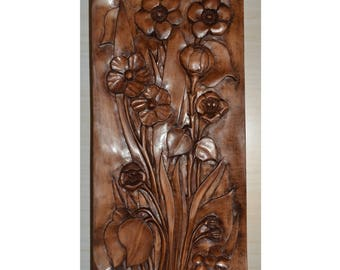 Spring flowers. Relief on limewood board. Handcarved decorative sculpture for wall.