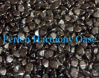 150 St. Black opaque white luster pinch-bead 5 x 3 mm