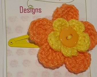 yellow and orange flower hair clip