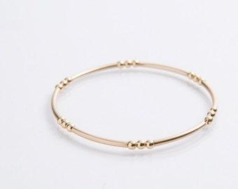 Gold Bead Noodle Bracelet