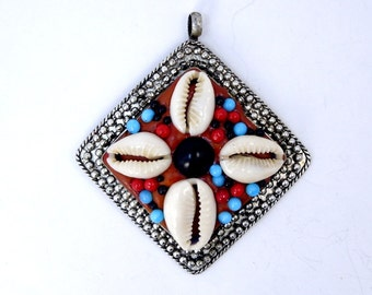 Tibetan pendant etsy silver toned tibetan pendant with cowrie shells and multi colored beads and repousse edges blue aloadofball Choice Image