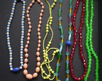 Lot of six bright colourful plastic beaded necklaces, child's jewellery 1960s
