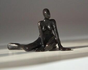 Bronze scupture sitting female figure