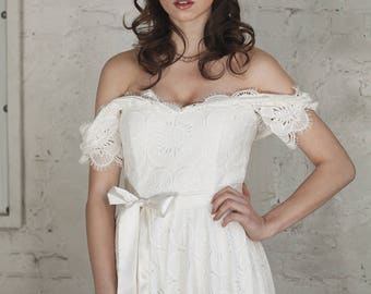 Off the shoulders ivory lace wedding dress