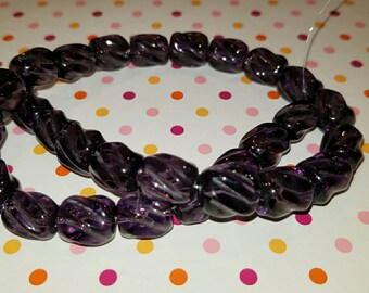 Glass swirl beads amythest color