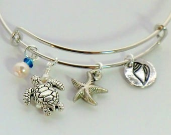 SALE! Stackable beach charm bangle, antique silver turtle, starfish and shell charms, adjustable, Capri blue swarovski, pearls, ocean sea