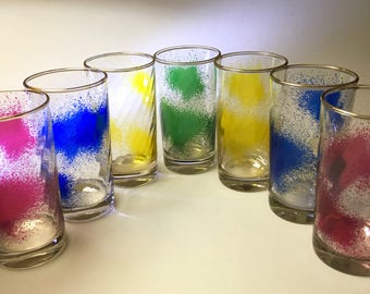 Set of seven artistic glass tumblers in assorted colors accented with gold