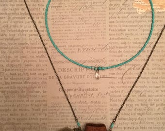Genuine leather AMULET pouch necklace with crystal point, turquoise beads and feathers. HAND-SEWN