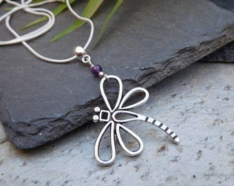 Darting Dragonfly pendant. Silver charm with an Amethyst bead.
