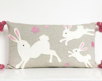 Jumping Bunny Lumbar Pillow in Creamy White and Pink Felt on Oatmeal Cotton/Linen with Pink Tassels