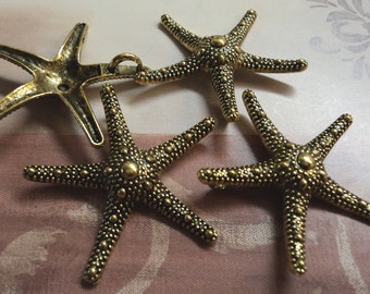 Pewter Goldtoned Star fish Starfish with pendant ring in back 4 pieces